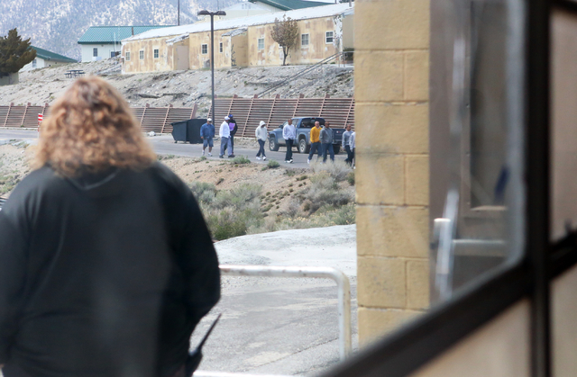 Youth at the Spring Mountain Youth Camp walk toward the gym under the watchful eye of a probation officer on Wednesday, April 22, 2015. Professional boxers and boxing referees visited the camp, wh ...