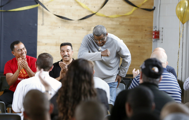 Veteran referee Robert Byrd takes a bow as he is introduced at the Spring Mountain Youth Camp Wednesday, April 22, 2015.  Professional boxers and boxing referees visited the camp, where young men  ...