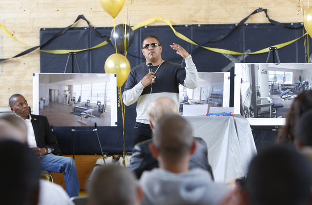 Boxer Fernando Vargas speaks to youth at the Spring Mountain Youth Camp Wednesday, April 22, 2015, as Clark County Commissioner Lawrence Weekly, left, looks on.  Professional boxers and boxing ref ...