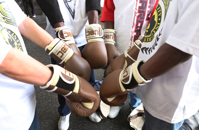 Young boxers at the Spring Mountain Youth Camp show off their boxing gloves on Wednesday, April 22, 2015.  Professional boxers and boxing referees visited the camp, where young men ages 12 to 18 a ...