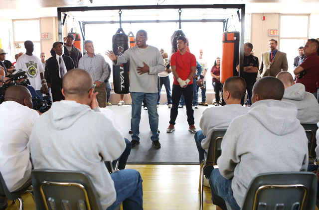 Veteran referee Robert Byrd gives a pep talk to youth as referee Russell Mora, third left, and boxer Jessie Vargas, right, look on at the Spring Mountain Youth Camp Wednesday, April 22, 2015. Prof ...