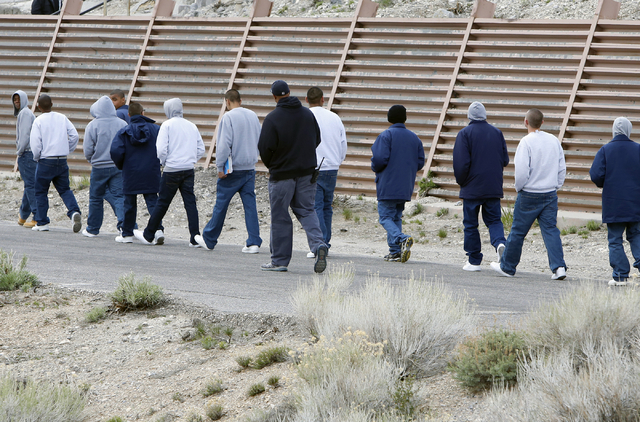 Youth walk to their camp after meeting with professional boxers and referees at the Spring Mountain Youth Camp Wednesday, April 22, 2015.  Professional boxers and boxing referees visited the camp, ...