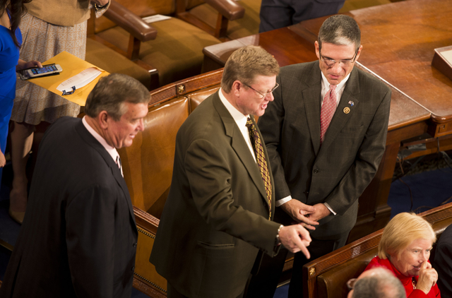 Nevada Republican Reps. Cresent Hardy, Mark Amodei and Joe Heck congregate on the U.S. House floor Tuesday awaiting the gaveling in of the 114th Congress. Photo by Lisa Helfert, special to Stephen ...