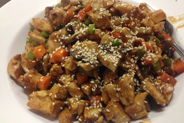 The chicken teriyaki stir-fry is seen at Muscle Maker Grill. It features grilled chicken breast, portabello mushrooms, onions, peppers, carrots and sesame seeds with teriyaki sauce over brown rice ...