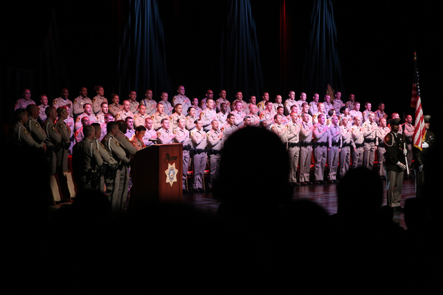 New police officers recite the Pledge of Allegiance during the Las Vegas Metropolitan Police Department graduation ceremony for the class of 11-2014 at the Orleans casino-hotel in Las Vegas Wednes ...