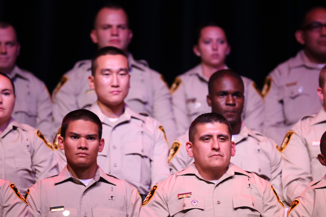 New police officers sit during the Las Vegas Metropolitan Police Department graduation ceremony for the class of 11-2014 at the Orleans casino-hotel in Las Vegas Wednesday, May, 2015. (Erik Verduz ...