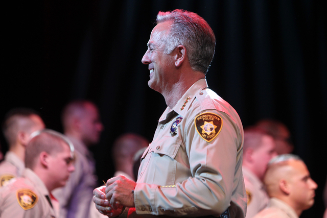 Clark County Sheriff Joe Lombardo waits to award new police badges to police academy graduates during the Las Vegas Metropolitan Police Department graduation ceremony for the class of 11-2014 at t ...