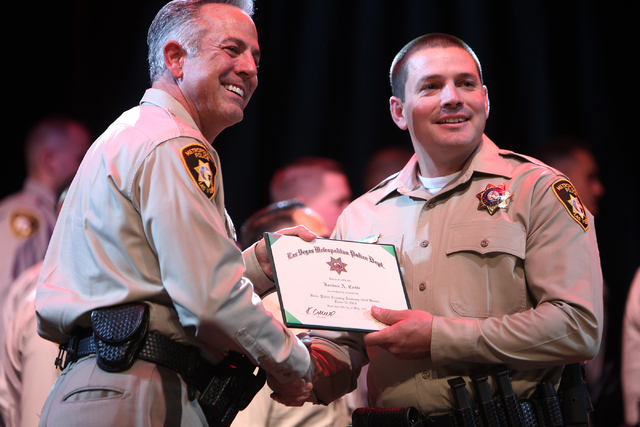 Clark County Sheriff Joe Lombardo, left, poses for a photo with police academy graduate Joshua Conte during the Las Vegas Metropolitan Police Department graduation ceremony for the class of 11-201 ...