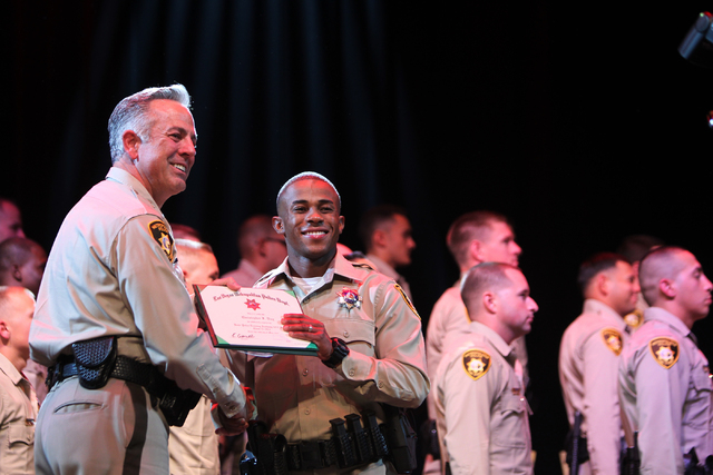 Clark County Sheriff Joe Lombardo, left, poses for a photo with police academy graduate Christopher Day during the Las Vegas Metropolitan Police Department graduation ceremony for the class of 11- ...