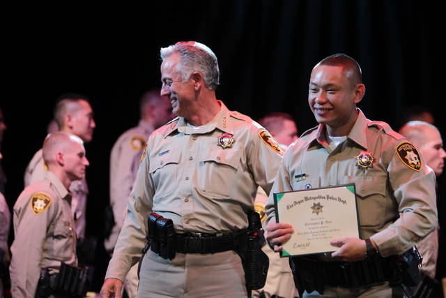 Clark County Sheriff Joe Lombardo, left, poses for a photo with academy graduate Christopher Dihn during the Las Vegas Metropolitan Police Department graduation ceremony for the class of 11-2014 a ...