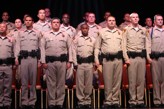 New police officers are sworn during the Las Vegas Metropolitan Police Department graduation ceremony for the class of 11-2014 at the Orleans casino-hotel in Las Vegas Wednesday, May, 2015. (Erik  ...
