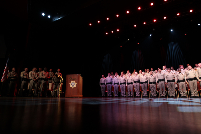 New police officers recite the Oath of Office during the Las Vegas Metropolitan Police Department graduation ceremony for the class of 11-2014 at the Orleans casino-hotel in Las Vegas Wednesday, M ...