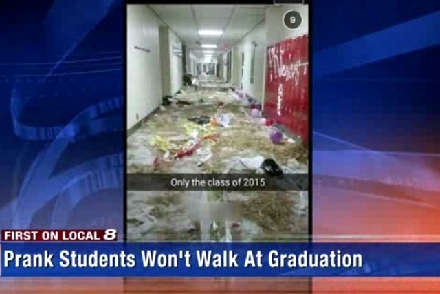 Teacher were forced to help with the cleanup while the rest of the school was kept in the gym for hours. (Screengrab, WVLT)