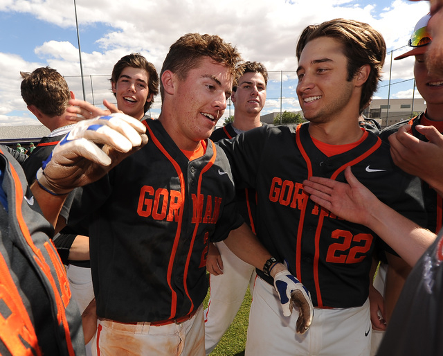 Bishop Gorman players celebrate with Cadyn Grenier, left, after he hit a walk-off home run in the ninth inning of the NIAA Division I State championship baseball game against Green Valley at Duran ...