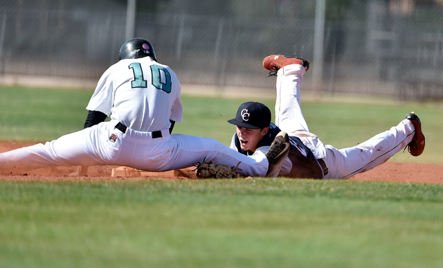 Coronado High School second baseman Anthony Olheiser dives to make the tag on Silverado's Chase Cortez during a first round game in the Sunrise Region baseball tournament at Silverado High School  ...