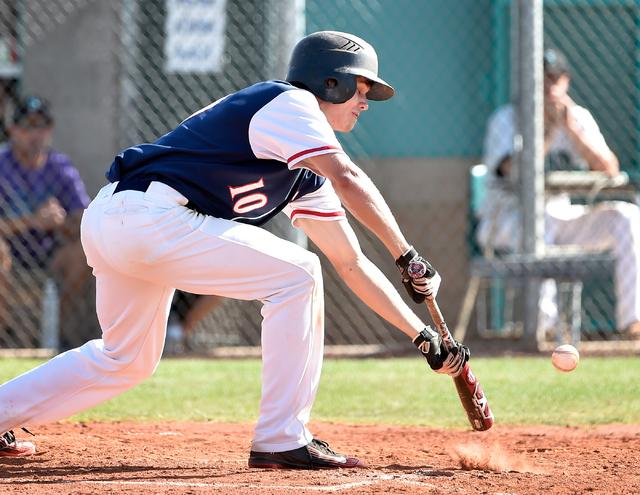 Coronado High School's Jacen Yergensen bunts the ball during a first round game in the Sunrise Region baseball tournament  against Silverado at Silverado High School on Tuesday, May 5, 2015, in He ...