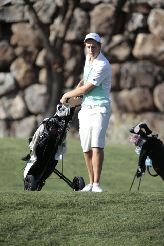Palo Verde High School's Jack Trent, prepares to move his golf bag, during the final round of the Division I Sunrise and Sunset region boys golf tournament at Reflection Bay Golf Club, Lake Las Ve ...