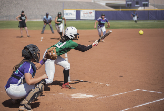 Rancho's Jahnae Davis-Houston (10) throws down a bunt against Silverado during the first round game of the Sunrise Regional tournament played at Silverado's softball field in Las Vegas on Tuesday, ...