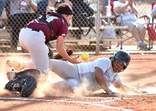 Sierra Vista's Kira Felise slides safely home as Faith Lutheran catcher Claire Peck drops the ball during a high school softball game at Faith Lutheran High School on Monday, April 20, 2015, in La ...