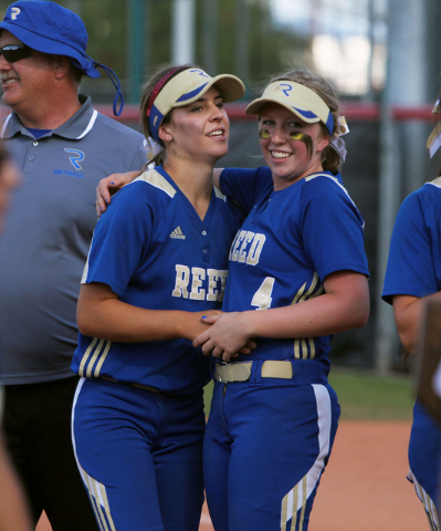 Reed pitcher Julia Jensen, left, celebrates with Mackenzie Howren who knocked in the winning run against Palo Verde after their Division I championship softball game Saturday, May 16, 2015, at UNL ...
