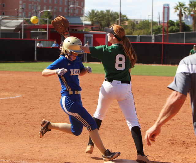 Reed's Cassy Walsh beats a throw to first but is called out anyway during their Division I championship softball game against Palo Verde Saturday, May 16, 2015, at UNLV. Reed won the game 3-2. (Sa ...