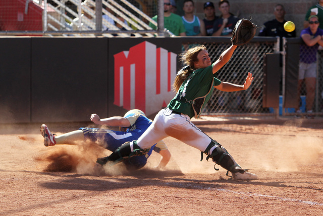 Reed's Ryia Grant slides into home for the winning run as Palo Verde catcher Kiley Harrison waits for the ball during their Division I championship softball game Saturday, May 16, 2015, at UNLV. R ...