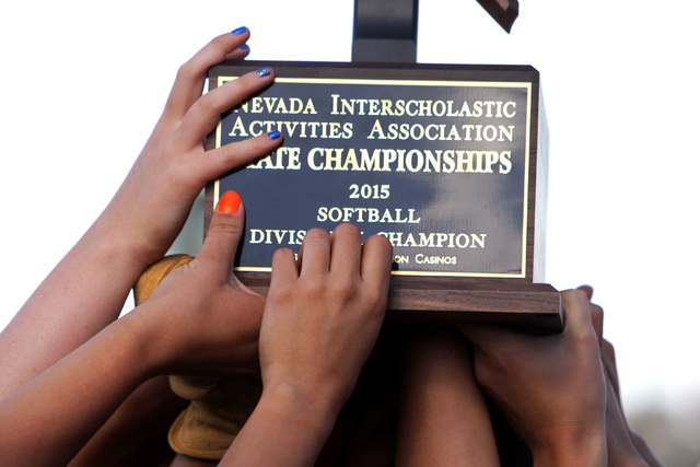 Reed players hoist their trophy aloft after defeating Palo Verde in their Division I championship softball game Saturday, May 16, 2015, at UNLV. Reed won the game 3-2. (Sam Morris/Las Vegas Review ...