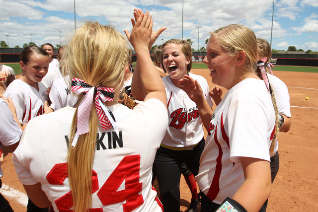 Lincoln County players celebrate their 8-3 win over White Pine County in their Division III championship game Saturday, May 16, 2015, at UNLV.  (Sam Morris/Las Vegas Review-Journal) Follow Sam Mor ...