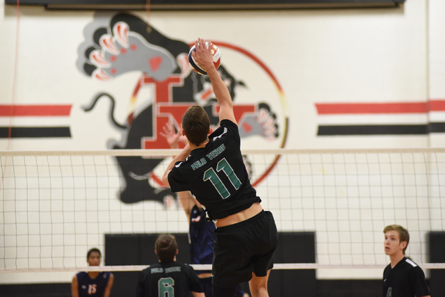 Palo Verde's Michael Simister (11) spikes the ball against Legacy during their Division I state volleyball final inside the Las Vegas High School gym in Las Vegas on Wednesday, May 13, 2015. Palo  ...