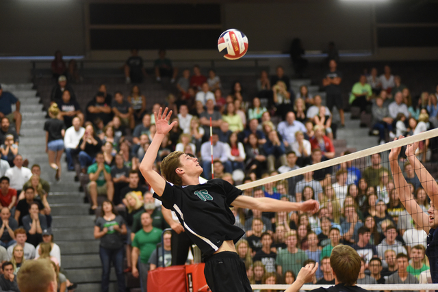 Palo Verde's Tyler Klingensmith (16) spikes the ball against Legacy during their Division I state volleyball final inside the Las Vegas High School gym in Las Vegas on Wednesday, May 13, 2015. Pal ...