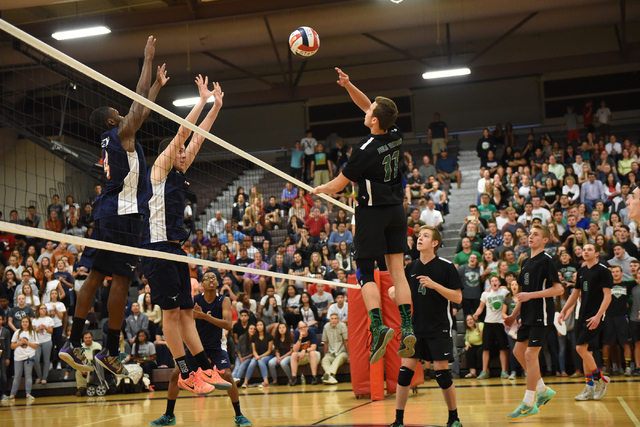 Palo Verde's Michael Simister (11) volley's the ball against Legacy during their Division I state volleyball final inside the Las Vegas High School gym in Las Vegas on Wednesday, May 13, 2015. Pal ...