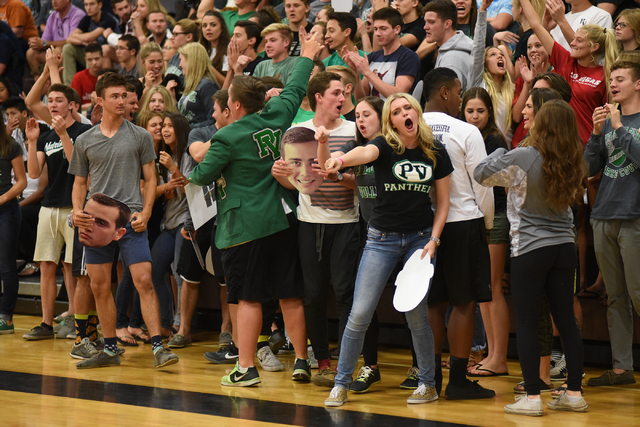 Palo Verde's student section cheer their team on against Legacy during their Division I state volleyball final inside the Las Vegas High School gym in Las Vegas on Wednesday, May 13, 2015. Palo Ve ...