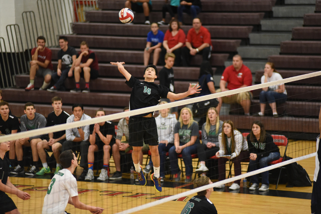 Palo Verde's Tristan Bradford (14) spikes the ball against Legacy during their Division I state volleyball final inside the Las Vegas High School gym in Las Vegas on Wednesday, May 13, 2015. Palo  ...