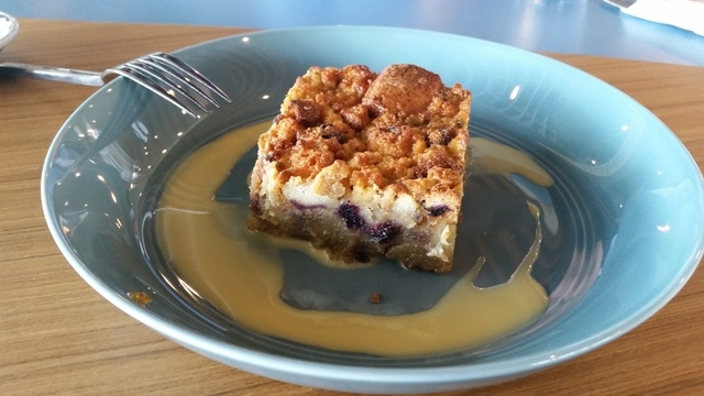 Warm bread pudding with burnt orange and anglaise is shown at PublicUs. (Lisa Valentine/View)