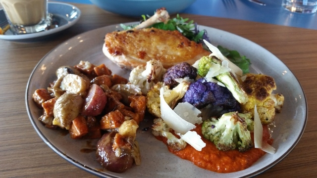 Pan-seared chicken breast is paired with sweet potato salad and cauliflower Romesco for one pretty plate of food at PublicUs. (Lisa Valentine/View)