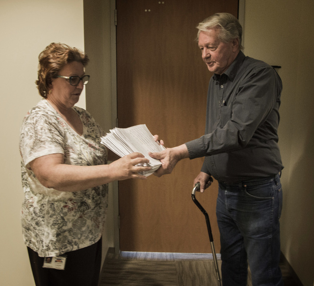 Bob Borgersen, left, gives North Las Vegas City Clerk Barbara Andolina  petitions to recall North Las Vegas municipal Judge Catherine Ramsey at  North Las Vegas City Clerk's office, 2250 Las Vegas ...