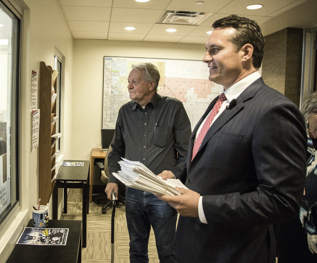 Attorney Ross Miller,right, and Bob Borgersen arrives with petitions to recall North Las Vegas municipal Judge Catherine Ramsey at the North Las Vegas City Clerk's office, 2250 Las Vegas Boulevard ...