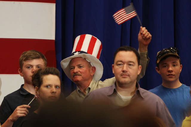 A supporter in a stars and stripes themed top hat waves a flag as U.S. Sen. Rand Paul, R-Ky., leaves a campaign rally in Las Vegas Saturday, April 11, 2015. (Sam Morris/Las Vegas Review-Journal) F ...
