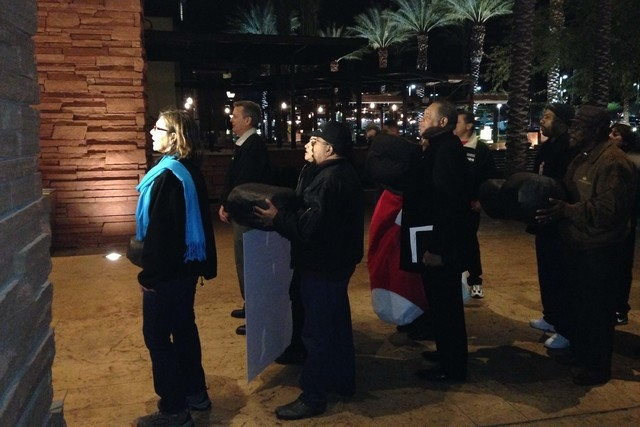 Culinary Secretary-Treasurer Geocanda Arguello-Kline, left, leads a group of union members and clergy to than main entrance of Red Rock Resort in Las Vegas, Nev., on Dec. 11, 2014, to deliver hand ...