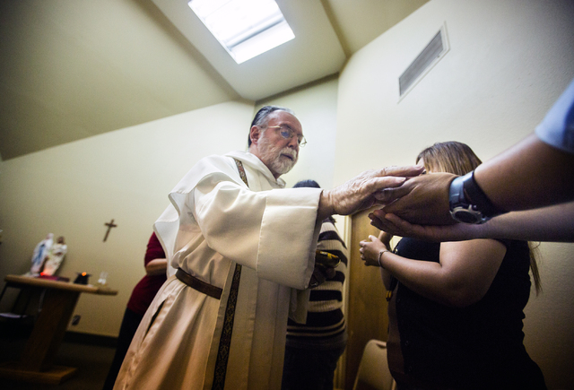 Rev. Albert Felice-Pace conducts mass at St. Thomas Aquinas Catholic Newman Center, 4765 Brussels Road, on Wednesday, May 6, 2015. He is retiring after 11 years at the UNLV location and 53 years i ...