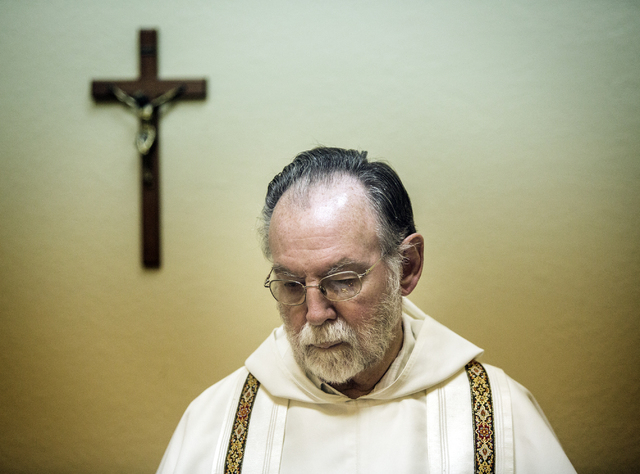 Rev. Albert Felice-Pace conducts mass at St. Thomas Aquinas Catholic Newman Center, 4765 Brussels Road, on Wednesday, May 6, 2015.He is retiring after 11 years at the UNLV location and 53 years in ...
