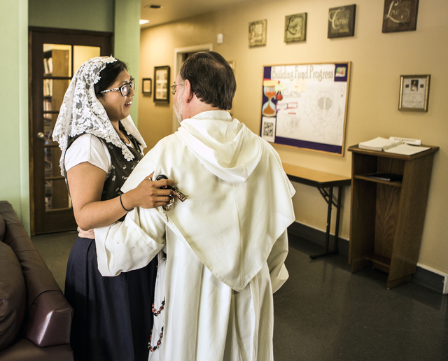 Rev. Albert Felice-Pace,right,  talks Karla Yeung before mass at St. Thomas Aquinas Catholic Newman Center, 4765 Brussels Road, on Wednesday, May 6, 2015. He is retiring after 11 years at the UNLV ...