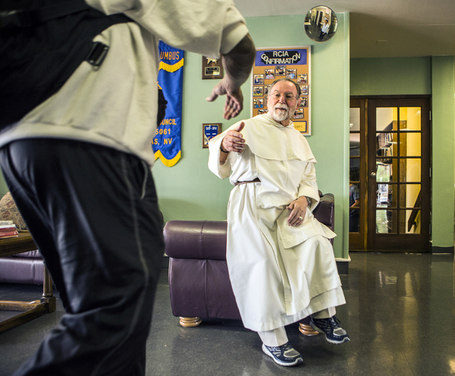 Rev. Albert Felice-Pace greets a parishioner at St. Thomas Aquinas Catholic Newman Center, 4765 Brussels Road, on Wednesday, May 6, 2015.  He is retiring after 11 years at the UNLV location and 53 ...