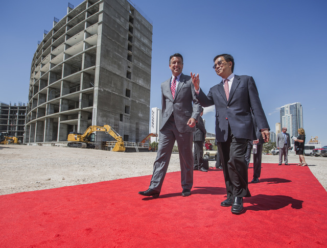K.T. Lim, chairman,right,  CEO of Genting Group, walks with Gov. Brian Sandoval  during the groundbreaking of  the $4 billion Resorts World Las Vegas resort property, the site of the former Stardu ...