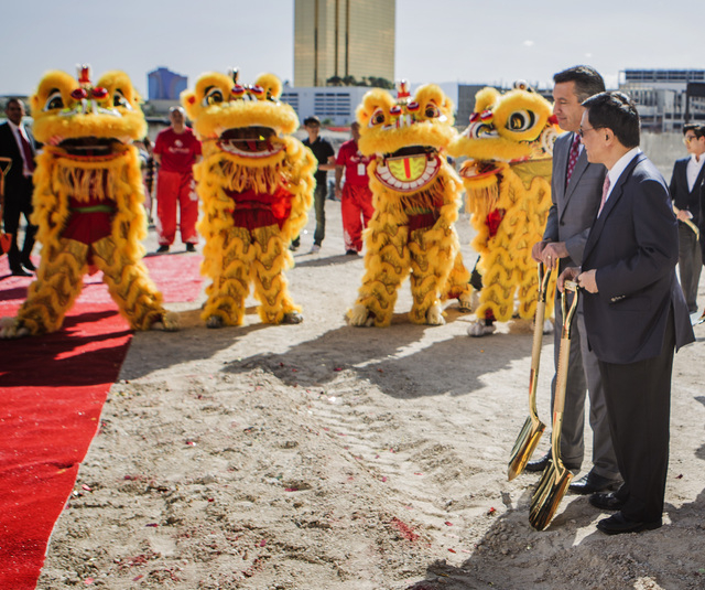 K.T. Lim, chairman,right,  and CEO of Genting Group, walks with Gov. Brian Sandoval  during the groundbreaking of  the $4 billion Resorts World Las Vegas resort property, the site of the former St ...