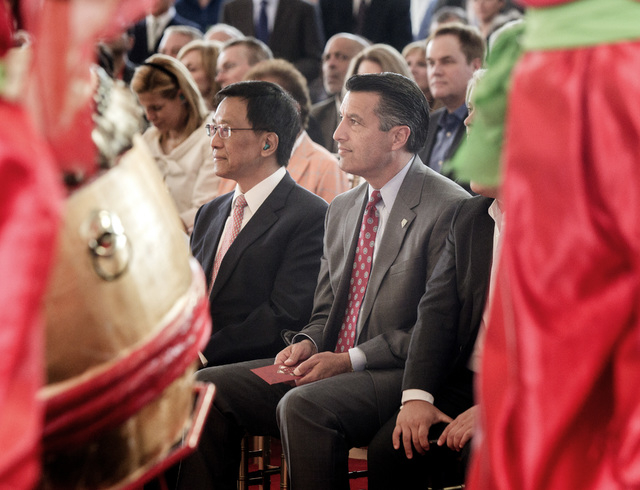 K.T. Lim, chairman,left,  and CEO of Genting Group, and Gov. Brian Sandoval watch the Resorts World Lion Dancers  during the groundbreaking of  the $4 billion Resorts World Las Vegas resort proper ...