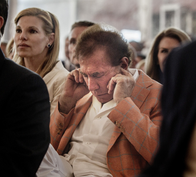 Steve Wynn, CEO of Wynn Resorts places earplugs while the  Resorts World Lion Dancers perform  during the groundbreaking of  the $4 billion Resorts World Las Vegas resort property, the site of the ...