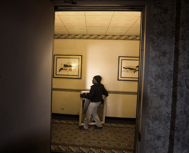 Glenn Jenkins carries a mirror that she is planning on purchasing during the liquidation sale at the closed Riviera hotel-casino, 2901 South Las Vegas Boulevard, on Wednesday, May 13, 2015. Former ...