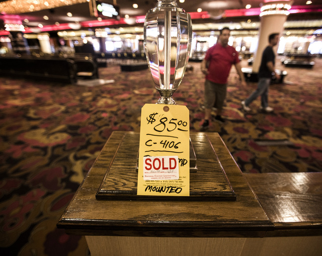 Men walk through the main casino of the closed  Riviera hotel-casino, 2901 South Las Vegas Boulevard. Former employees were able to purchase merchandise early. (Jeff Scheid/Las Vegas Review-Journa ...