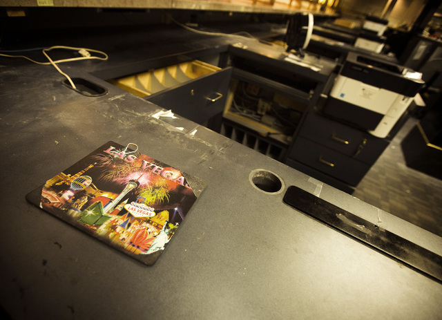A mouse pad is seen Wednesday, May 13, 2015 in the casino cage of the closed Riviera hotel-casino, 2901 South Las Vegas Boulevard. Former employees were able to purchase merchandise early at the l ...